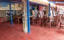 Mesas no Interior do Atlântico Bar e Restaurante