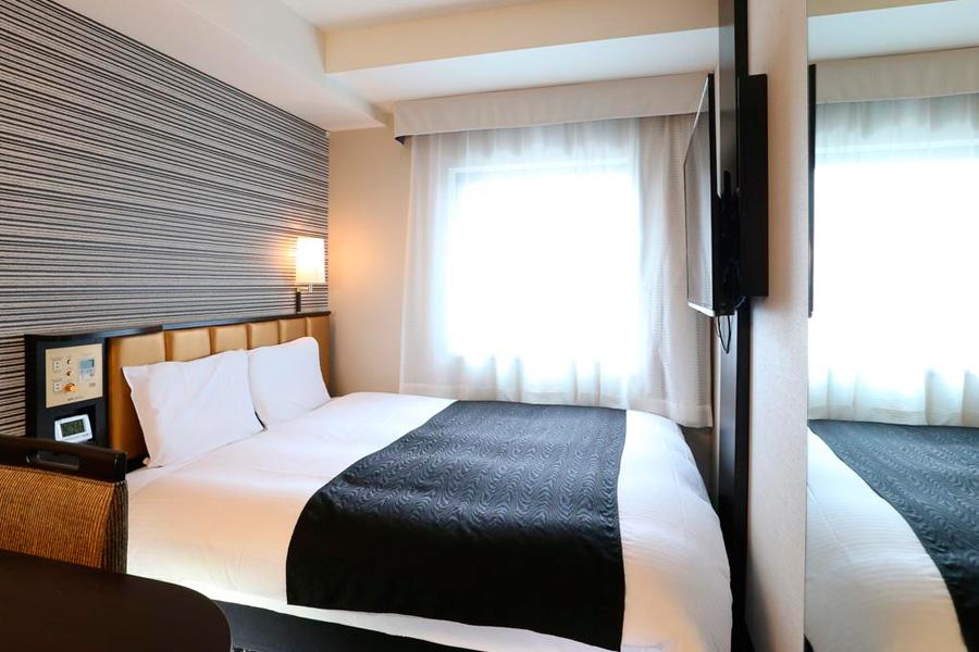 Quarto do hotel Shinagawa Sengakuji-Ekimae